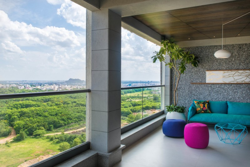 contemporary balcony with glass railing system playful & colorful side chairs turquoise sofa and table corner white planter grey laminated floors