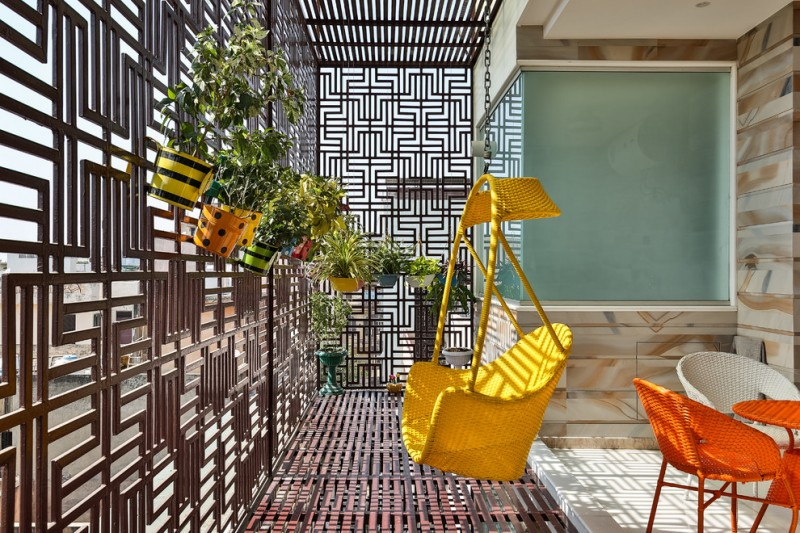 contemporary enclosed balcony with linear concept yellow swing orange furniture set linear concept floors some wall mounted planters