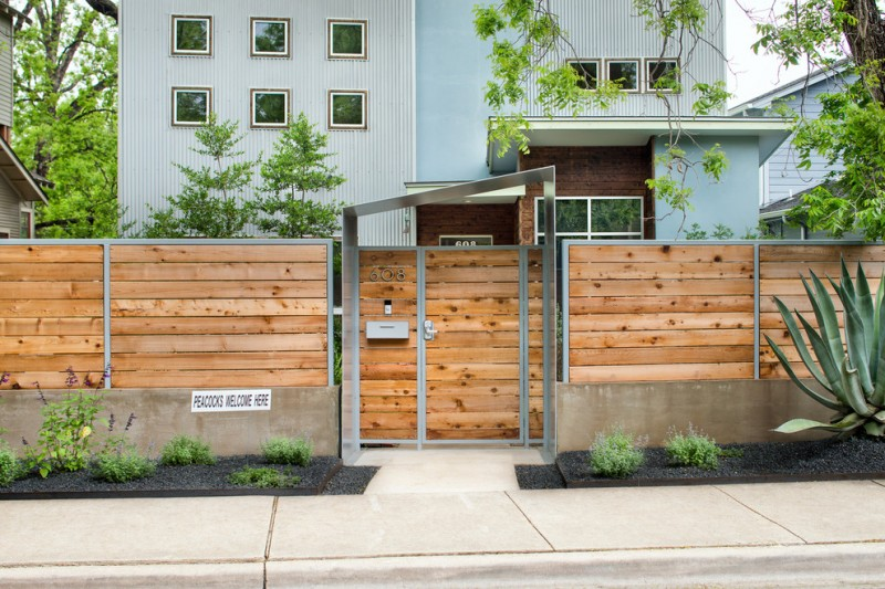 contemporary horizontal cedar fences accented by iron plates