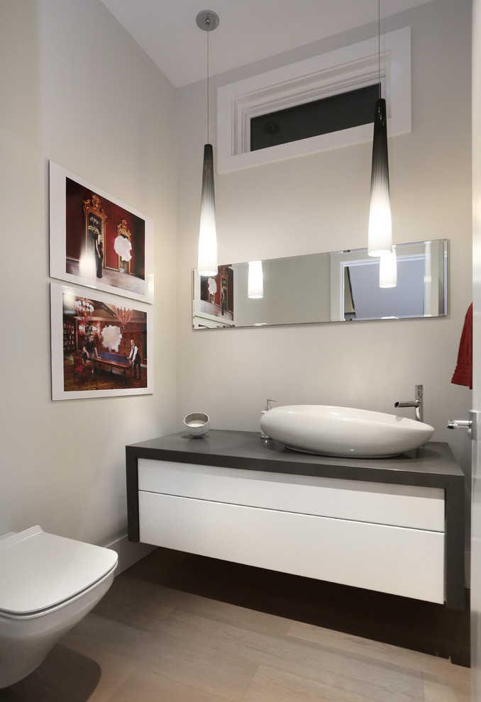 contemporary powder room grey painted cherry countertop and sides white gloss vessel sink frameless mirror stainless steel faucet drop shaped pendant lamps