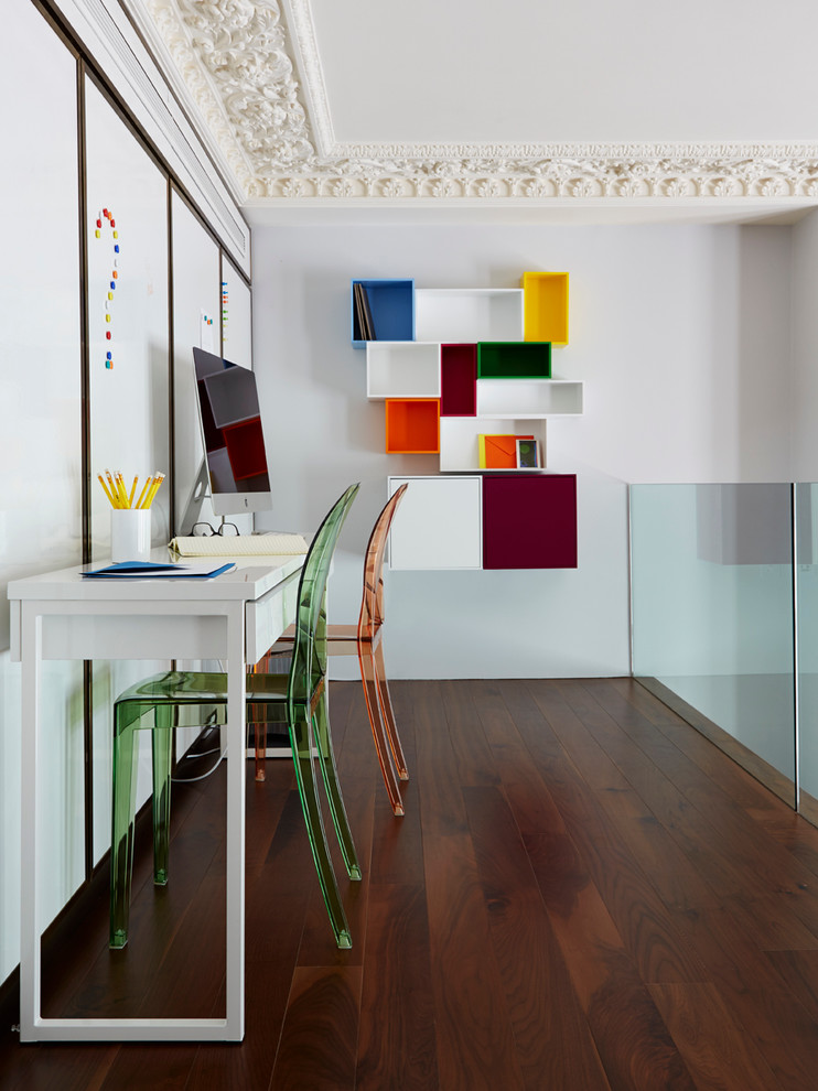 contemporary working space idea dark toned wood floors white walls stylish floating shelving cluster in pop colors green & orange acrylic working chairs white working desk