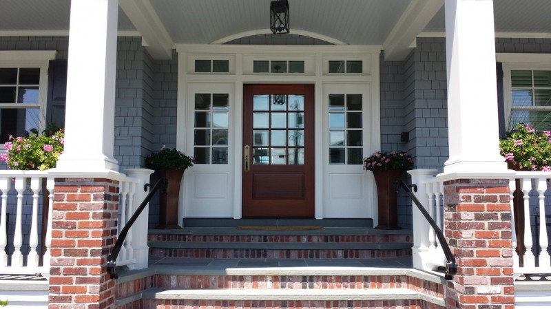 craftsman entryway idea mahogany colonial front door with reflective glass panels a couple of reflective glass windows as sidelights grey wood shingles