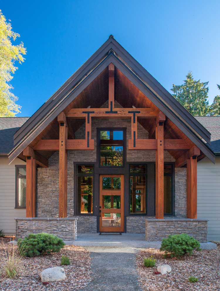 craftsman exterior design clean lines & rustic front door and windows with dark toned wood trims and glass panels stones exterior walls exposed exterior beams
