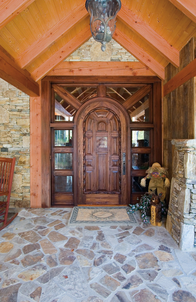 craftsman exterior idea hardwood colonial front door with sidelights arched wood roof stone flooring idea stones exterior walls