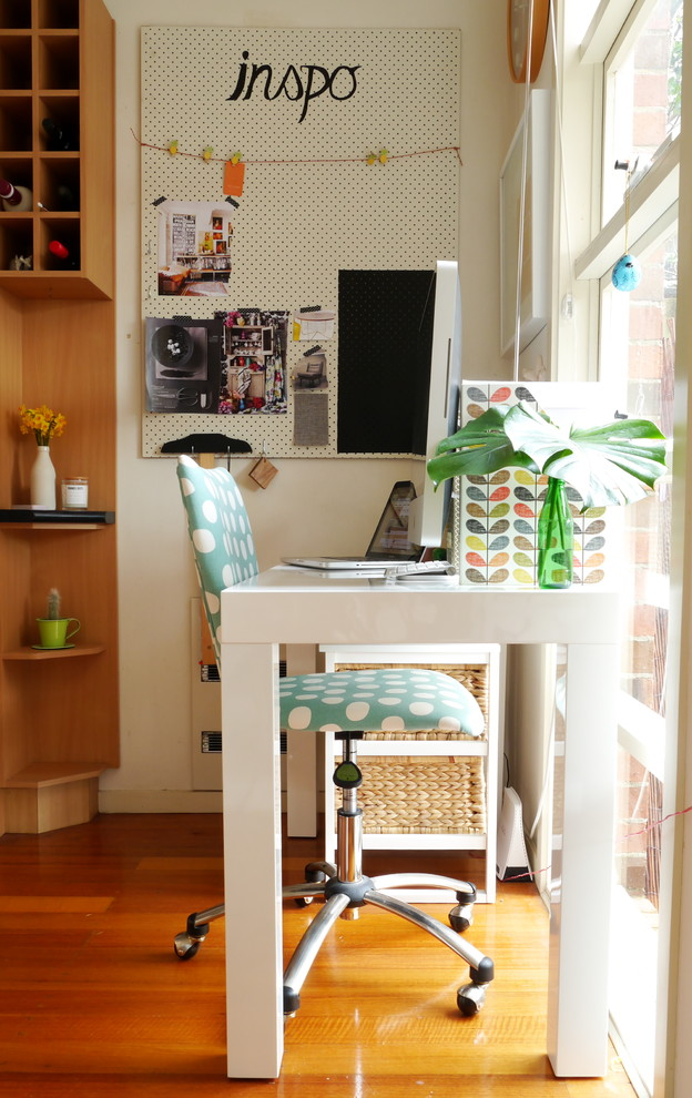 eclectic home office idea paper wrapped stryfoam board for messages board white vanity for working table movable working chair with polka dots accents medium toned wood floors