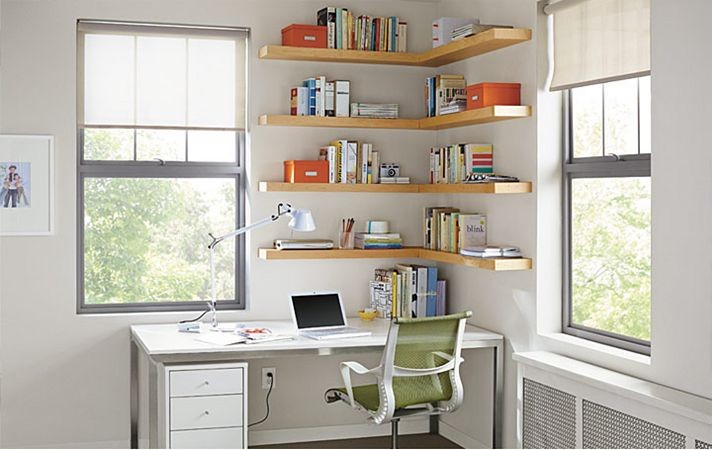 modern home office design corner wood wall shelving units white working desk with drawer system modern green working chair with wheels