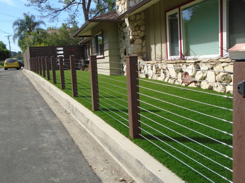 modern landscaping idea stainless steel fencing with wood vinyl posts