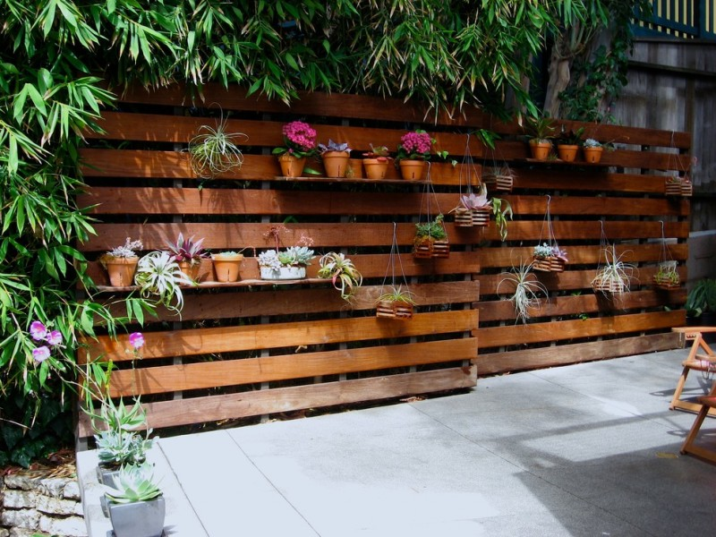 modern patio idea modern wood fences idea with clay burnt planters concrete floors