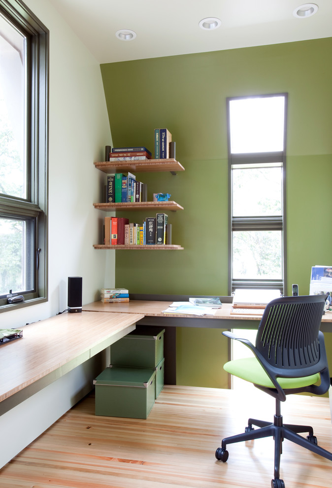 modern study room idea L shaped floating desk with wood top green working chair with wheels simple and small wood floating wall organizers pale toned wood floors