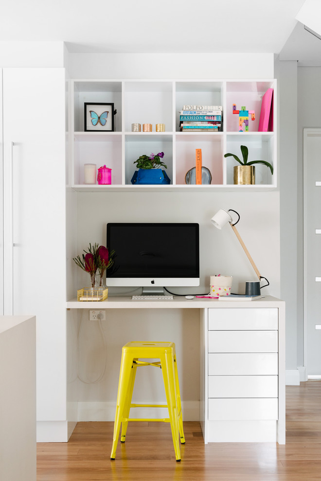 modern white home office idea white shelves white working desk yellow working chair
