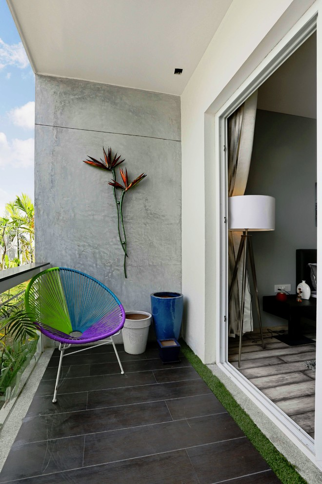 narrow modern balcony concrete walls dark tiles flooring modern & colorful chair stunning wall decor