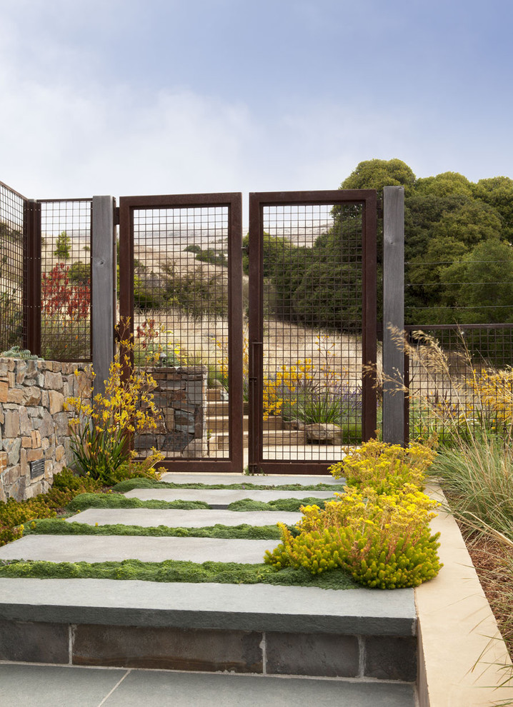 old and shabby look metal fences idea with lightweight metal nets support solid concrete pathway