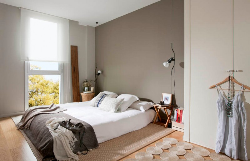 scandinavian bedroom idea paltform bed without headboard white bed linen grey blanket beige walls ceiling light fixtures looks like floor lamps