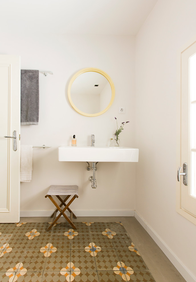 simpler scandinavian bathroom vanity floating farmhouse sink stainless steel faucet smaller x base wood chair round mirror with yellow frame white walls tiles floors with motifs