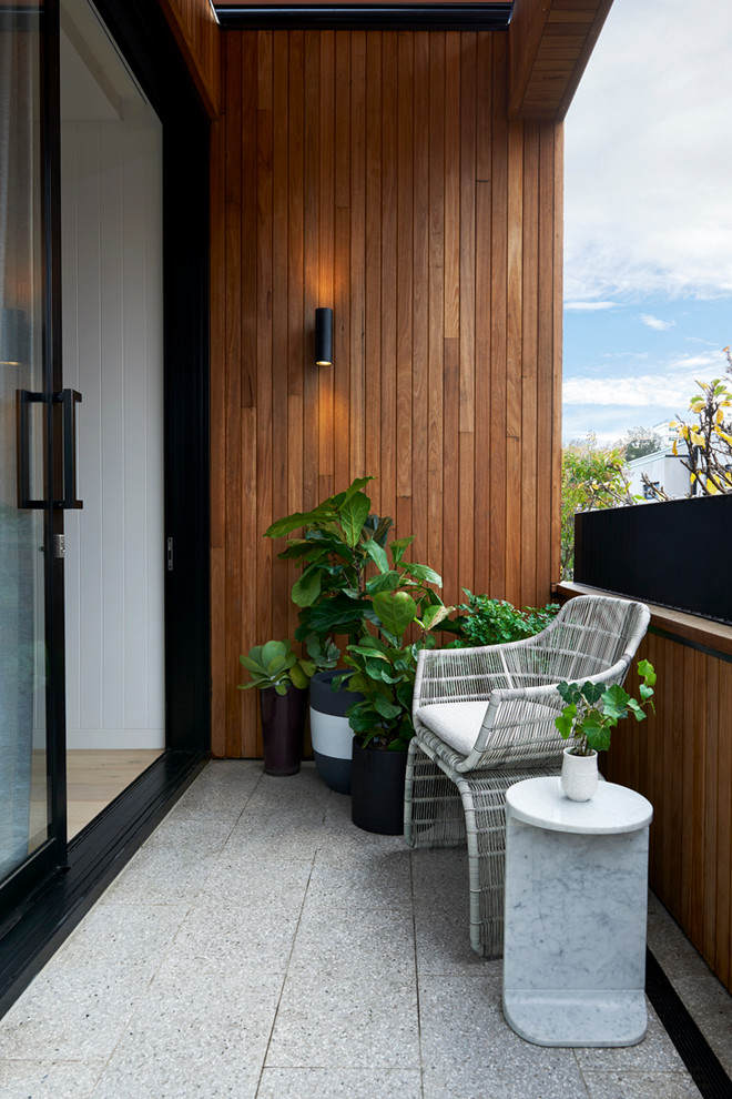 small contemporary balcony indoor facing furniture in white small sized planters with decorative plants vertical wood siding exterior walls modern wireless sonce tiles flooring idea wood siding rails