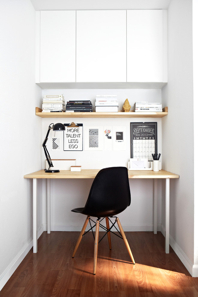 small sized scandinavian home office wood wall shelf upper cabinets in modern white wood top working desk without finishing black mid century modern chair with wood legs darker toned wood floors