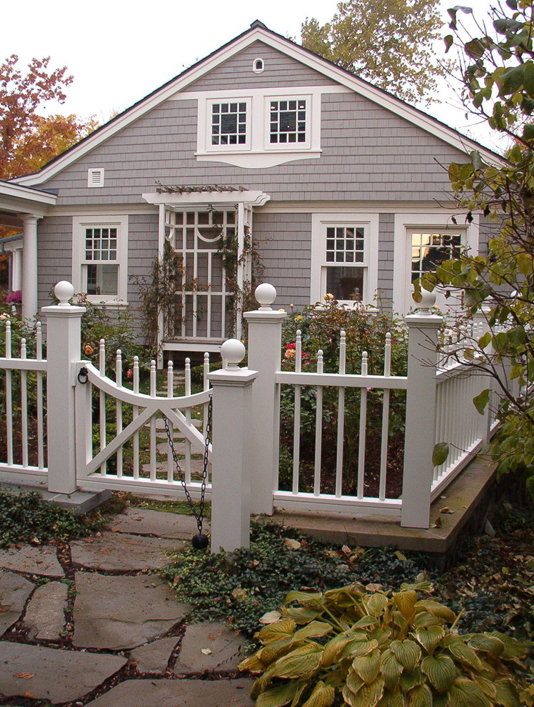 traditional landscape idea with gothic style fencing idea in white traditional exterior idea with white trims for door and windows