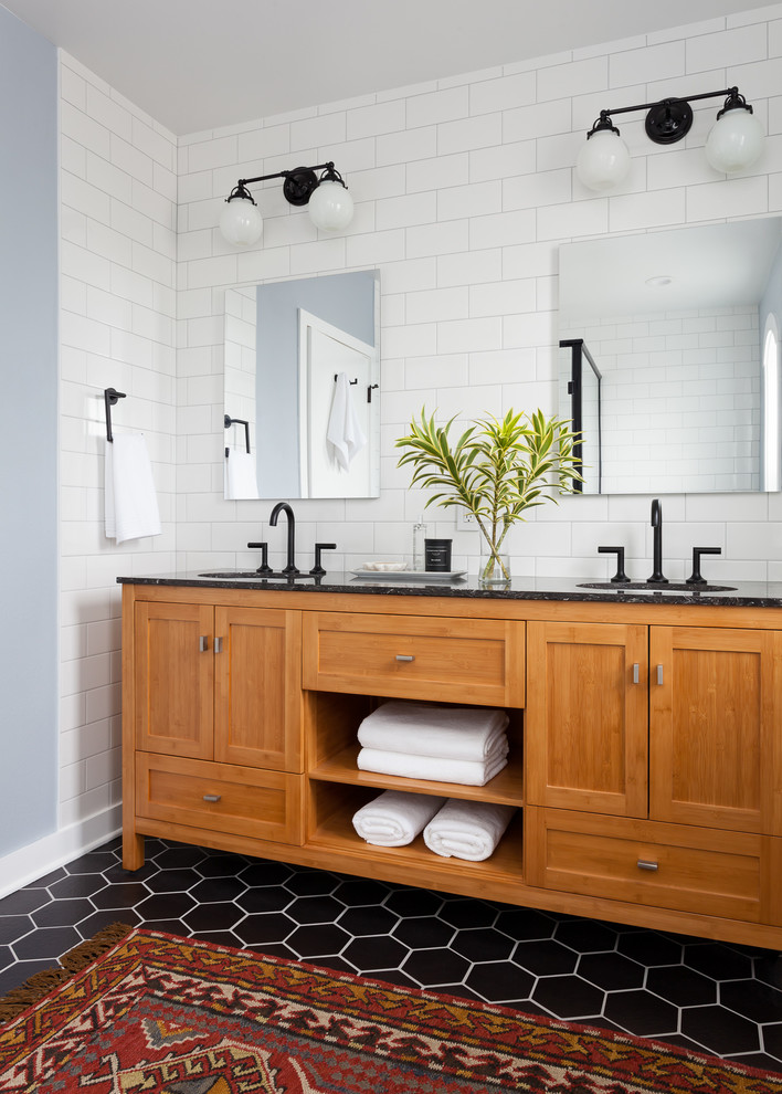transitional bathroom vanity idea marble countertop shaker cabinets with open shelves black wrought iron faucets white subway ceramic tiles walls two couples of bulb lighting fixtures black pentagon t