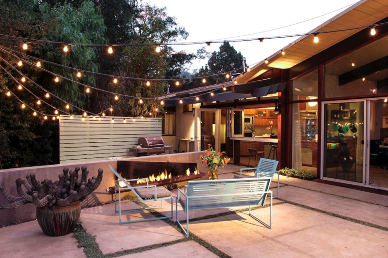 backyard patio idea bulb strings lighting fixtures half way private fencing system light blue metal outdoor furniture set large sized paving floors