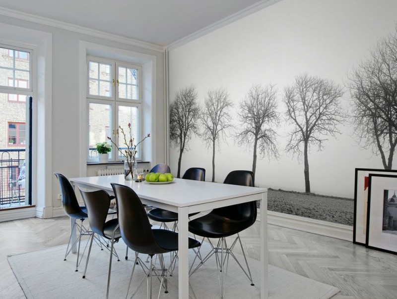 black molded plastic dining chairs white dining table leave less trees wall background white floors white walls