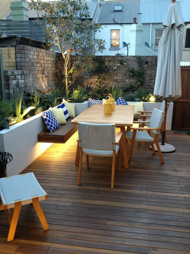 contemporary deck design soft light for plants lighting fixture beneath the bench modern outdoor furniture set wood board decking floors conrete white painted wall