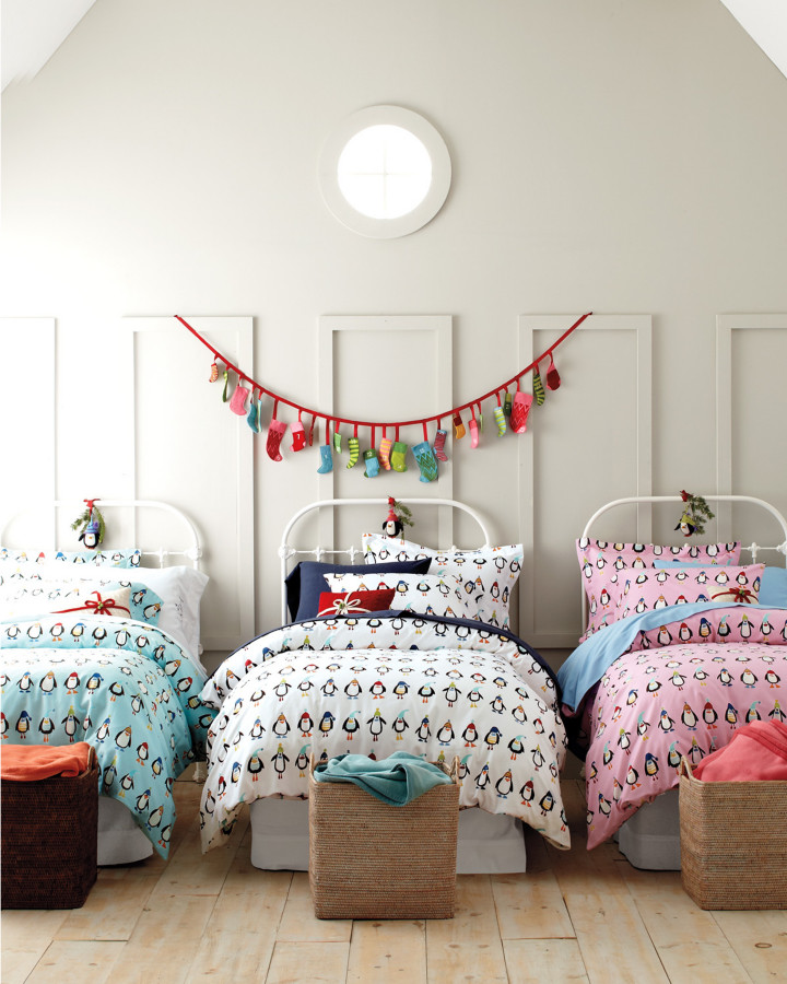 eclectic kids' bedroom idea white bed frames with white metal headboards light toned wood floors white wall backgrounds decorative flanel wall decors