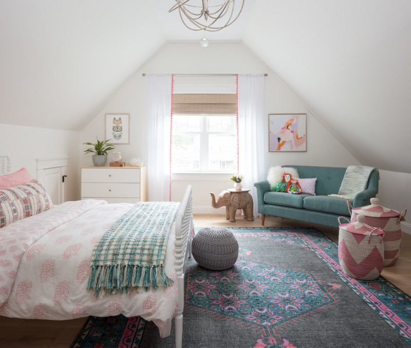 eclectic kids' bedroom in vintage style white bed frame with headboard light blue sofa slanted ceiling idea multicolored area rug white drawer system with wood countertop