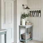 Farmhouse Entryway A Couple Of Small Side Tables In Light Blue White Tiled Floors Recessed Book Shelves Traditional Wall Mounted Light Fixtures