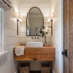 Farmhouse Powder Room Wood Counter Without Finish Smaller Farmhouse Sink In White Stripped Bathroom Mat White Siding Walls Wood Framed Mirror A Couple Of Vanity Light Fixtures