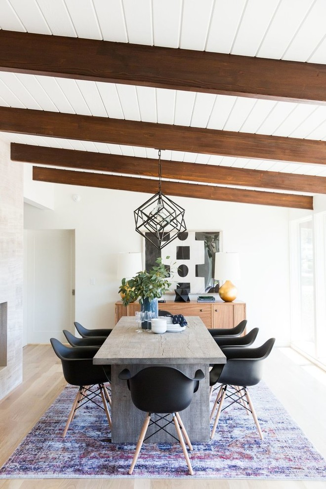 mid century modern dining room cementlike dining table black dining chairs shabby area rug exposed beams industrial pendant vintage wood made display cabinet