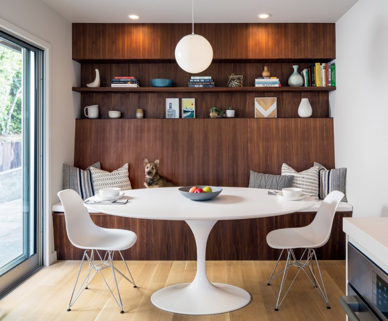 mid century modern dining room design wider round top marble dining table in white Eiffel tower base dining chairs in white dark wood bench integrated with shelf