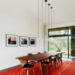 Mid Century Modern Dining Room Longer Wood Dining Table Wood Dining Chairs Large Red Carpet Lower Pendants Decorative Photographs