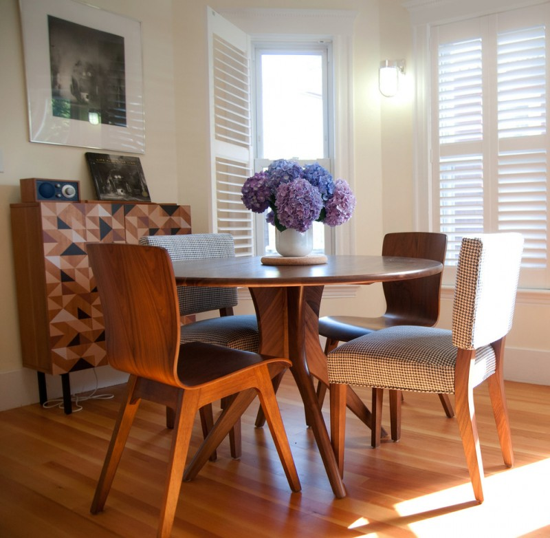 mid century modern dining room round shape walnut table fabricated chairs wood chairs medium toned wood floors