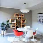 Mid Century Modern Dining Room Wood Shelves Colorful Dining Chairs With Eiffel Tower Base Cowhide Carpet LED Pendant In White