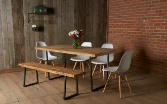 mid century modern rustic dining room white molded plastic chairs with wood legs industrial style bench and dining table shabby wood wall red brick wall shabby wood board floors