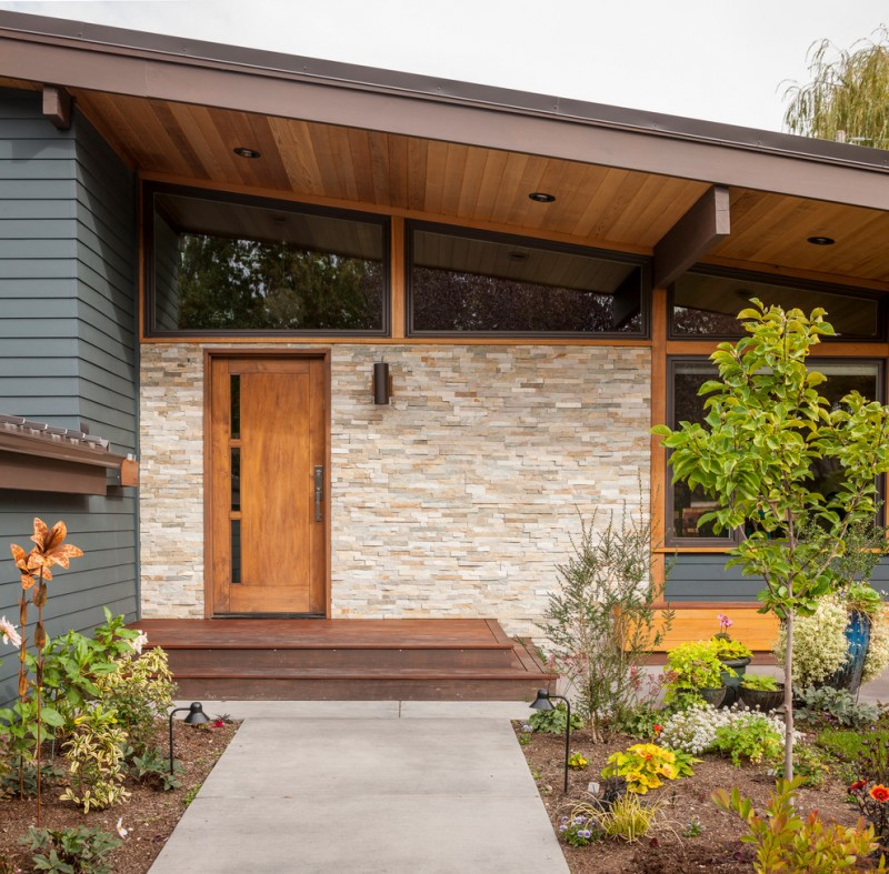 midcentury exterior idea medium toned wood front door whitewashed exterior wall grey siding exterior wall darker glass panel on top concrete pathway slanted wood roofs
