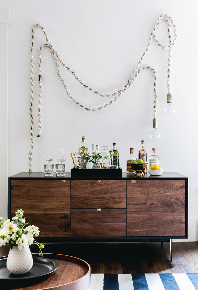 midcentury modern hall console idea with flat panels and dark finishing and also black frame decorative ball lamps with ropes