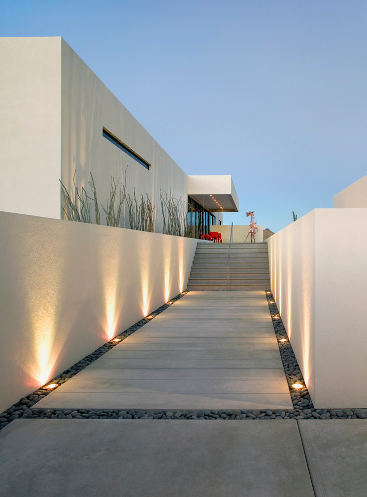 modern landscape idea concrete paving floors accented by stones concrete walls with wonderful shadows of light effect recessed garden light fixtures