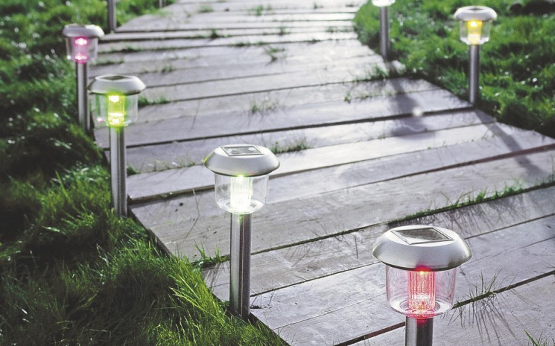 modern outdoor light fixtures with colorful electric bulbs and glass and metal shade