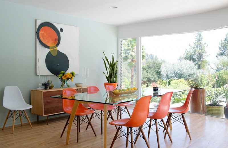 open plan mid century modern dining room orange dining chairs glass top dining table vintage appeal hall console white side chair