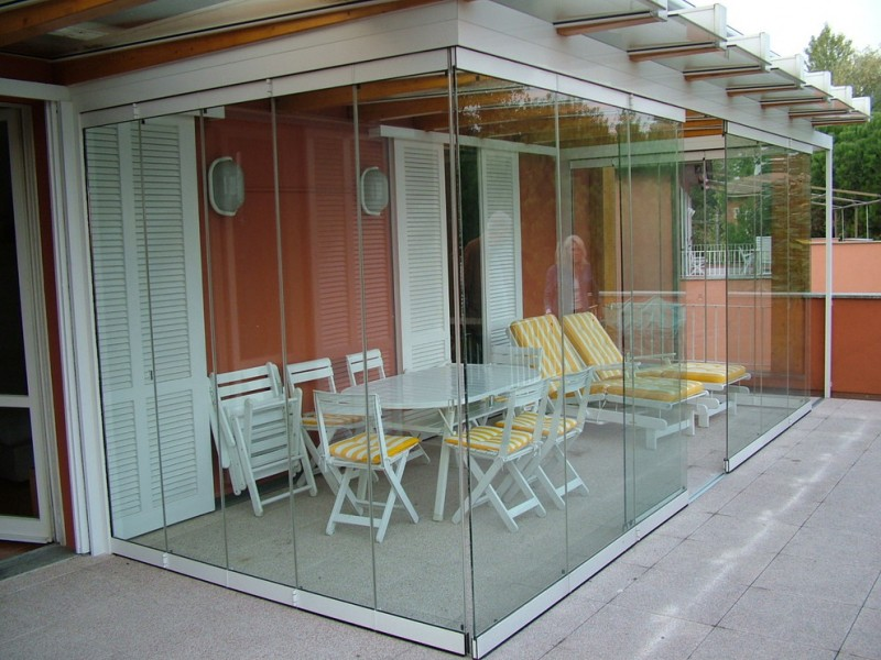 overall glass paneled sunroom idea modern outdoor chaises in stripped yellow white outdoor dining furniture set