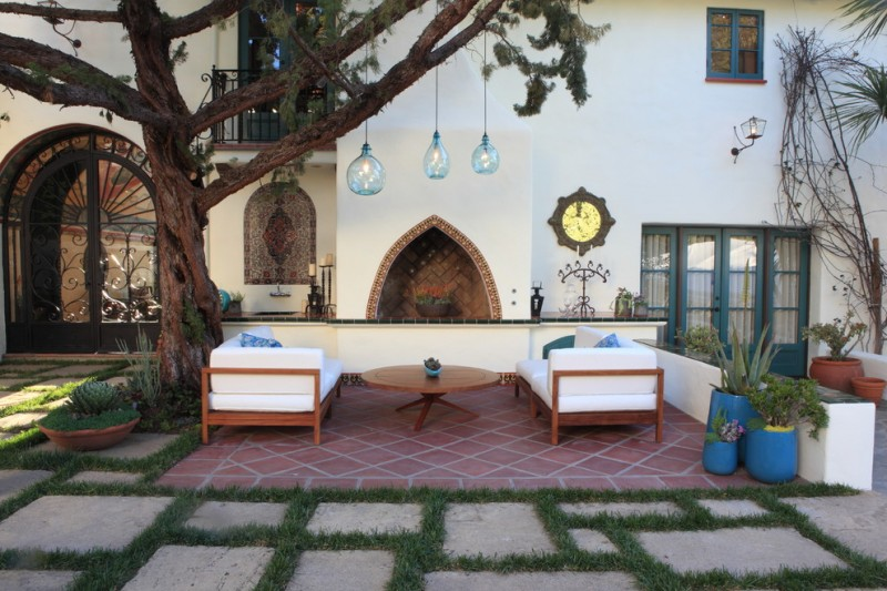 patio with different height & size pendants modern sofa in white round top wood table red tiles floors