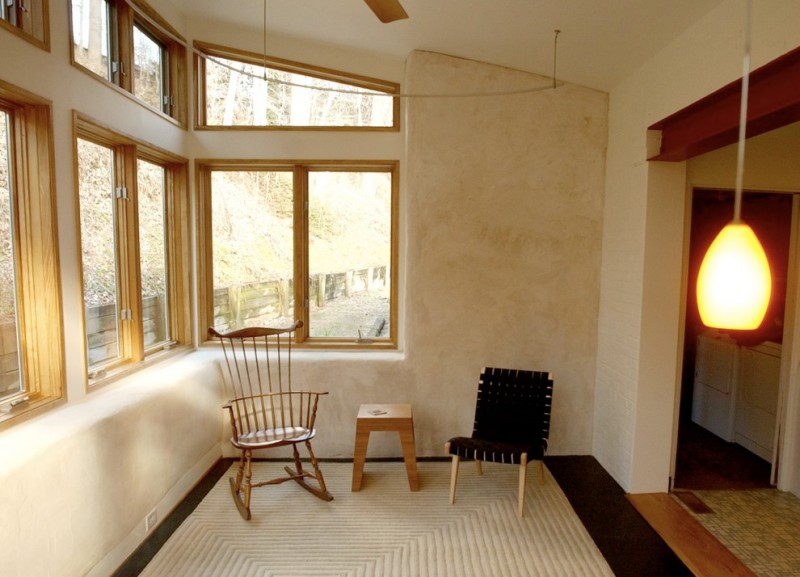small modern sunroom beige painted concrete walls small seats white textured area rug