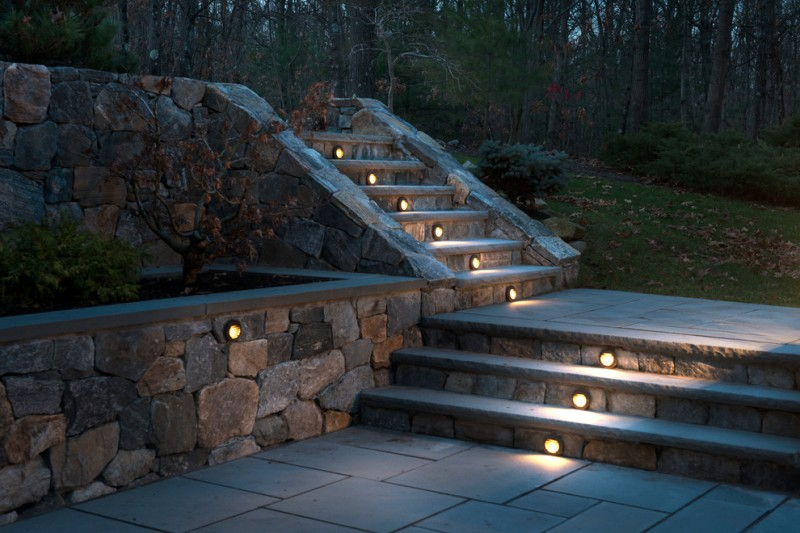 stone steps with recessed central lighting fixtures