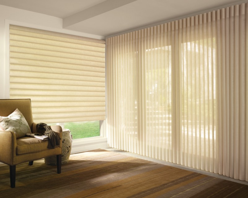 traditional sunroom idea Roman shades in light cream beige toned armchair medium toned wood floors