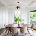 Transitional Dining Room White Walls Dark Pendant Soft Toned Mid Century Modern Dining Chairs Dark Wood Floors Medium Toned Wood Dining Table