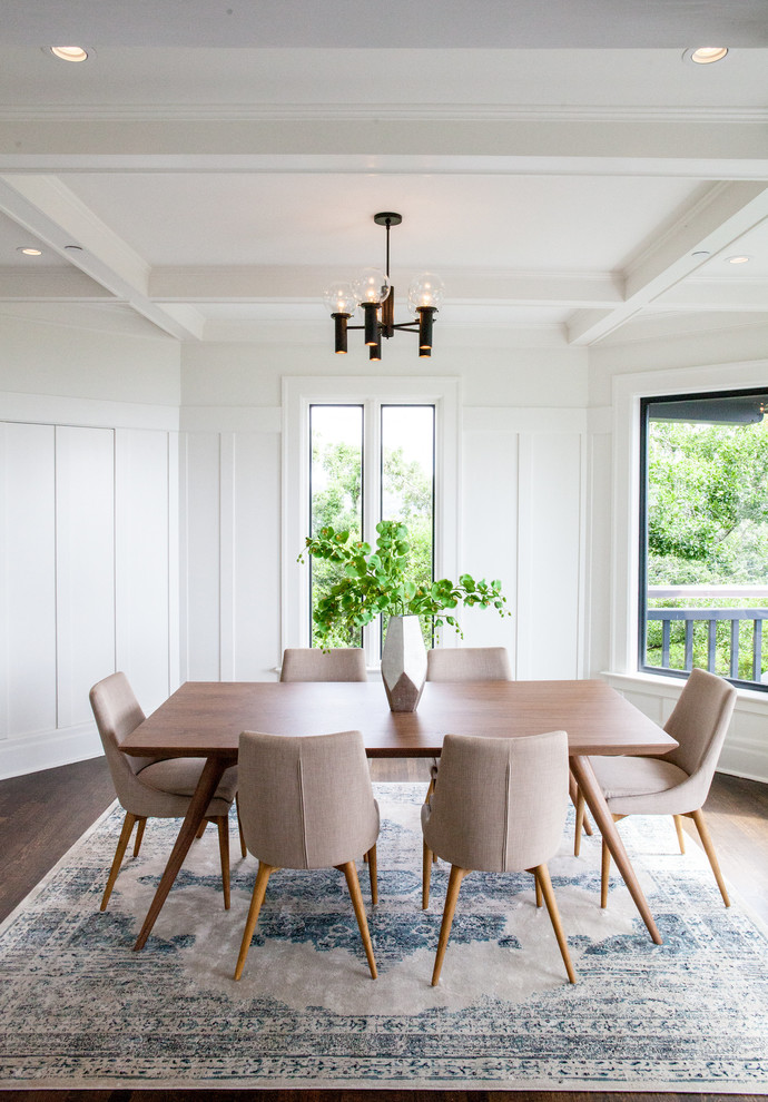 transitional dining room white walls dark pendant soft toned mid century modern dining chairs dark wood floors medium toned wood dining table