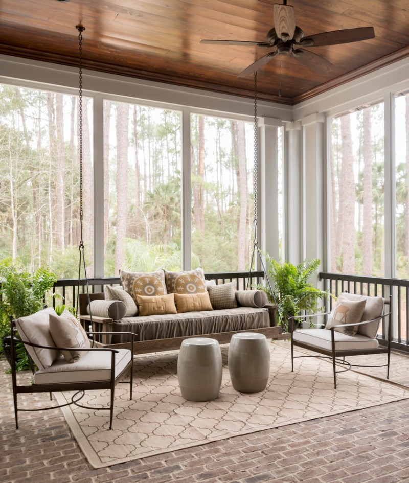 transitional sunroom daybed swing with throw pillows a couple of classic chairs pave floors textured area rug in soft tone wood ceilings