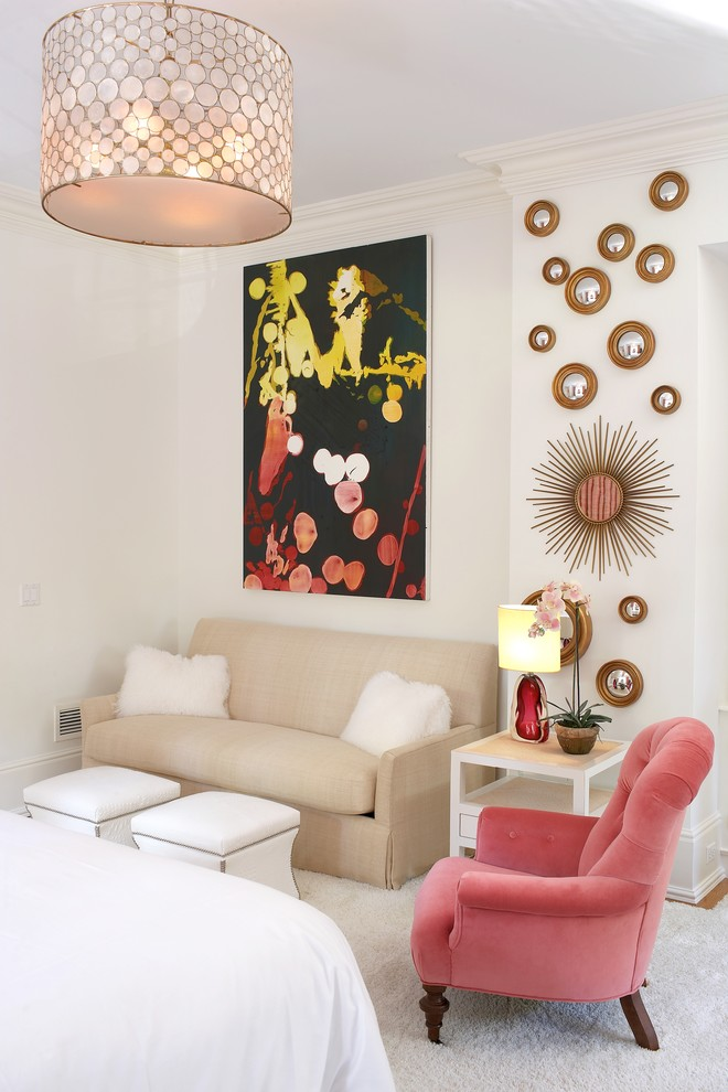 velvet armchair in soft pink cream sofa with fury coated pillows twins table slipcovers gold toned wall decors an abstract painting