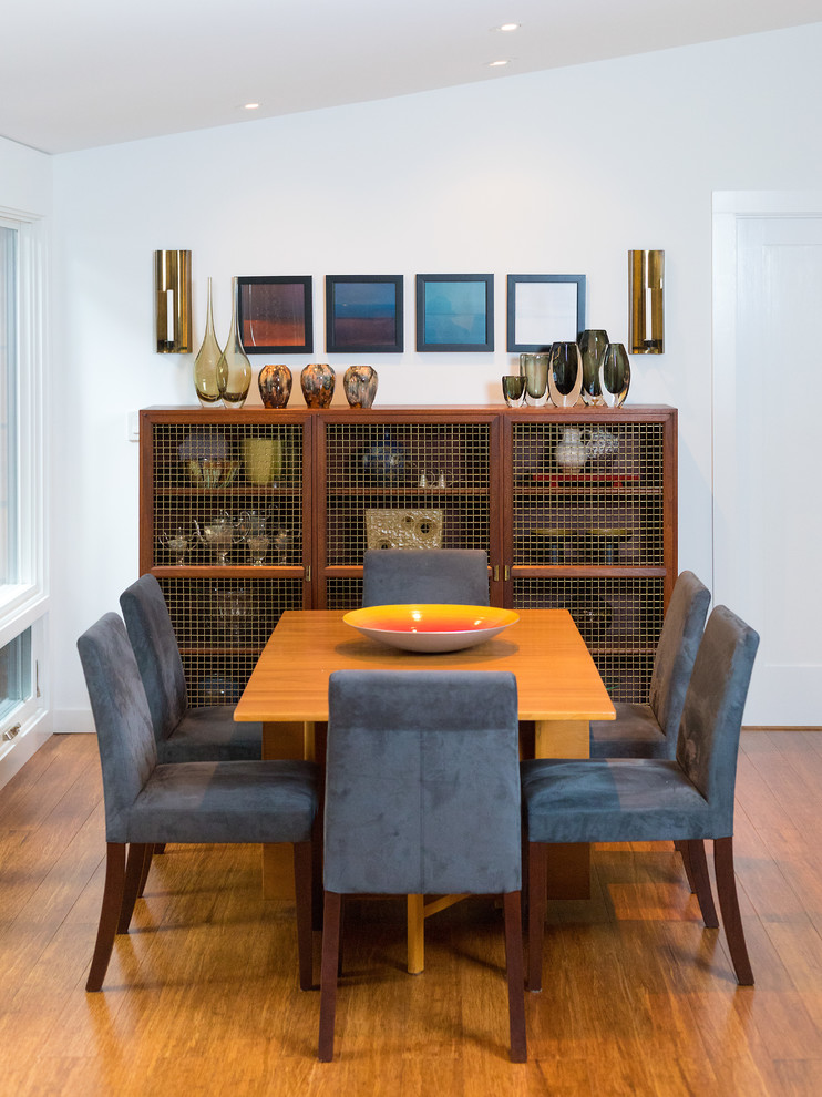 walnut display cabinets with wire net panels dark blue velvet chairs yellow table medium toned bamboo floors